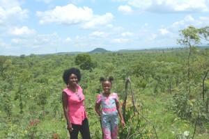 Marita Banda and Temwani Banda with the beautiful valley behind them.